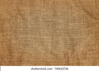 Brown crumpled burlap texture background, close up