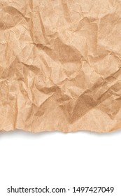 Brown crumpled wrapping paper with torn border as background