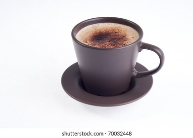 a brown cup of coffe
