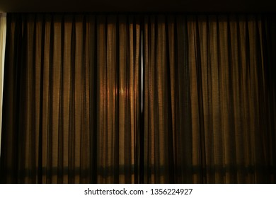brown curtain closed window in the morning