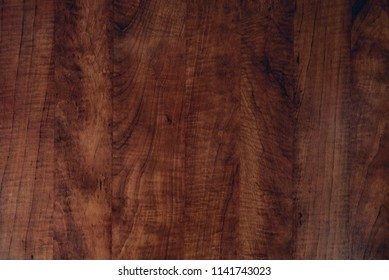 Brown dark scratched wooden cutting, chopping board. Wood texture.