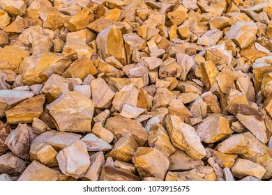 Brown decorative crushed stones for landscape design, decoration landscaping gardens and parks. Textural background of natural crushed marble.