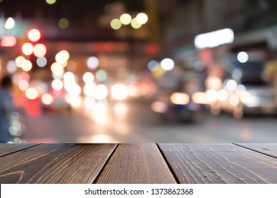 Brown desk on front blurred colorful traffic jam abstract background