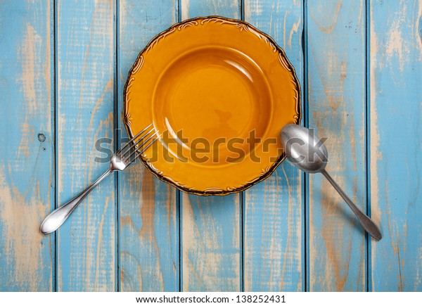 Brown dinner set on painted wooden board