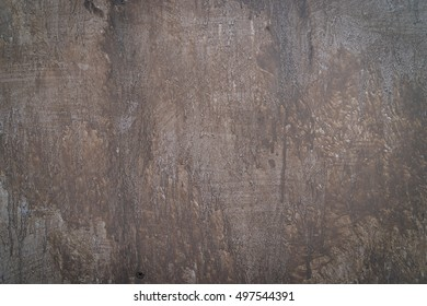 Brown Dirty wet painted cement wall for texture background