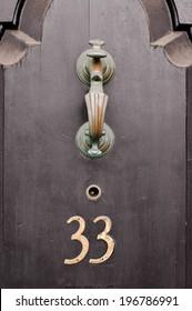 Brown door number 33.