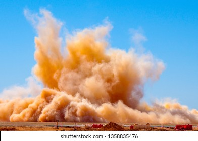 Brown dust clouds after the detonator blast on the site