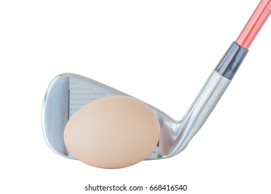 The brown egg in front of golf club on white background, healthcare lifestyle concept.