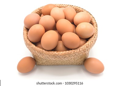 brown egg iin the basket, wicker solated on White Background