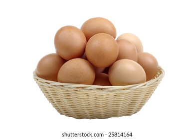 Brown eggs in basket for easter isolated on white background.