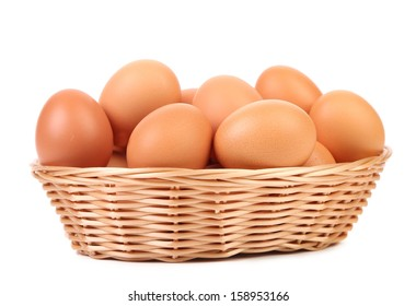 Brown eggs in the basket. Isolated on a white backgropund.