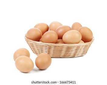 Brown eggs in the basket. Isolated on a white background.