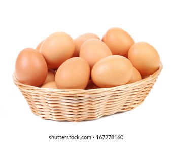 Brown eggs in the basket on a white. Isolated on a white background.