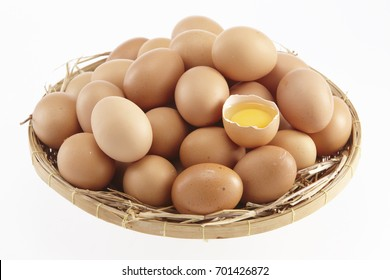 Brown eggs in the basket on white background