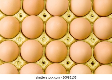 Brown eggs in cardboard box