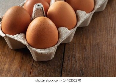 Brown eggs in a cardboard tray close up
