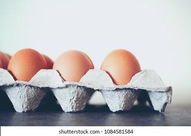 Brown eggs in carton cardboard box