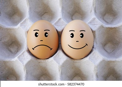 Brown eggs with face expression of sad and happy