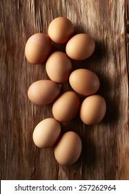 Brown Eggs Overhead on Wood