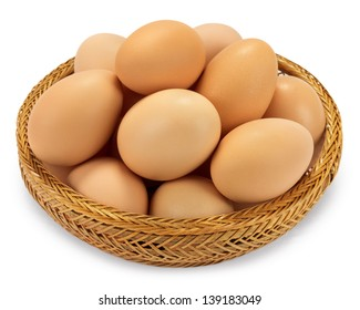 Brown eggs in a wicker basket isolated on white background
