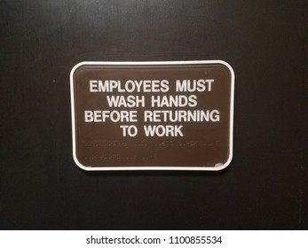 brown employees must wash hands before returning to work sign on door