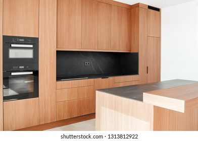 Brown empty classic kitchen. Kitchen appliances. Kitchen in Luxury Home with large island.