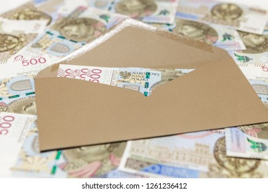 Brown envelope with 500 PLN banknotes on banknotes background