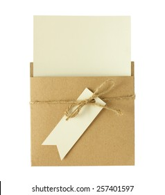 Brown envelope of recycle paper with a blank greeting card isolated on white background.
