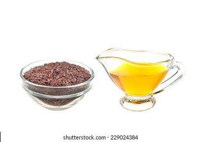 brown flax seed and linseed oil, isolated on white background