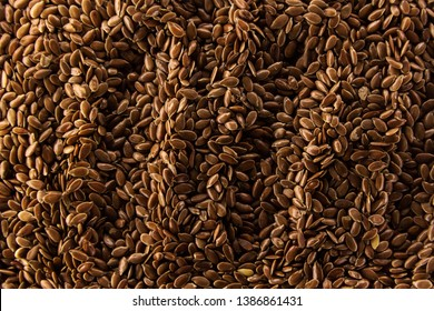 Brown flax seeds give flaxseed oil background