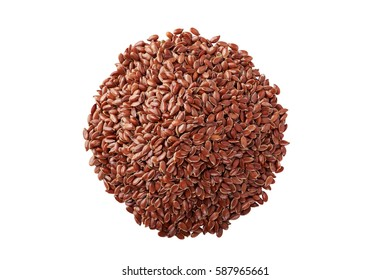 lot of brown flax seeds on white background