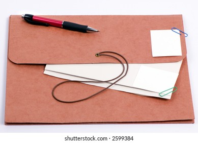 Brown folder with important confidential papers with pictures