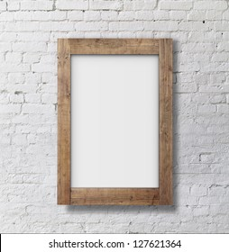 brown frame on brick wall