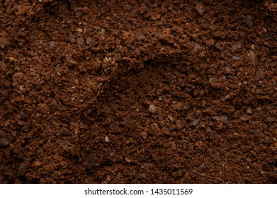 Brown fresh milled coffee texture macro close up view