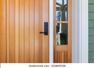 Brown front door with black door knob
