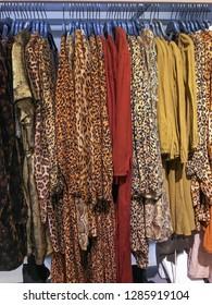 brown fur leather,jacket ,coat ,sweater  ,Leopard pattern clothes, sundress on hanger