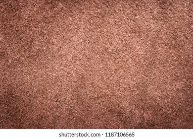 Brown ganuine buckskin suede leather as background wallpaper with copy space