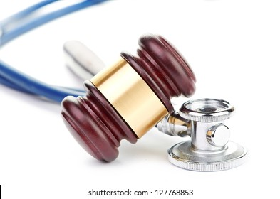 brown gavel and a medical stethoscope on white background