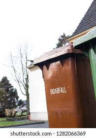 """Brown German Garbage Can for biodegradable Waste, Text saying """"Biodegradable Waste"""""""