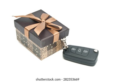 brown gift box and keys on white background