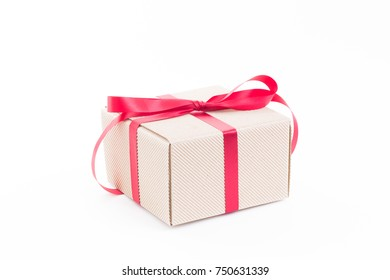 Brown gift box with red ribbon on white background