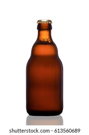 Brown glass beer bottle with yellow cap on white background with reflection