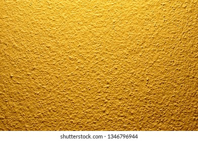 brown and gold concrete wall texture background