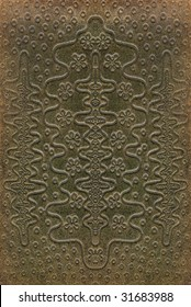 brown and green leathercraft tooled vintage book cover with texture and grain