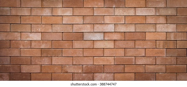 brown grunge brick wall abstract background, blurred and vignette corner