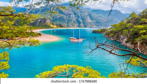 Brown gulet anchored at the Aegean sea - Panoramic view of Oludeniz Beach And Blue Lagoon, Oludeniz beach is best beaches in Turkey - Fethiye, Turkey