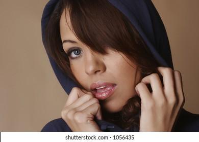 Brown hair female holding hood