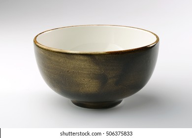 Brown hand-crafted bowl isolated on white background