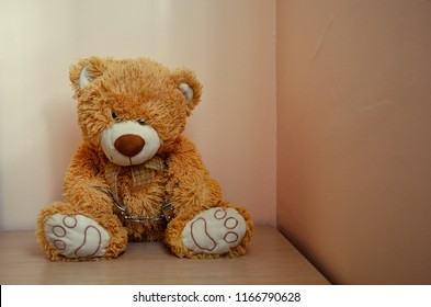 Brown Handcuffed Teddybear