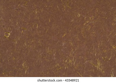 Brown handmade paper with yellow threads woven through it